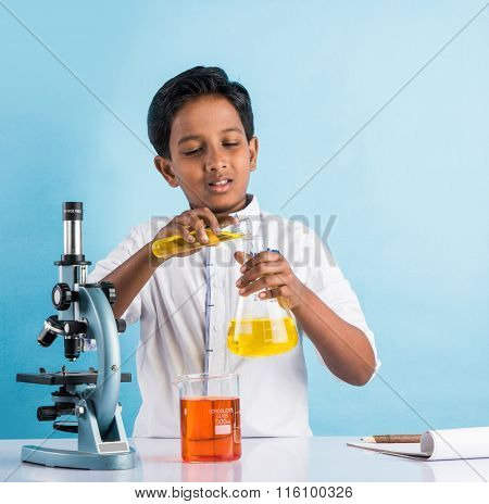 indian boy and chemistry experiment and microscope, asian boy with microscope and doing chemistry ex