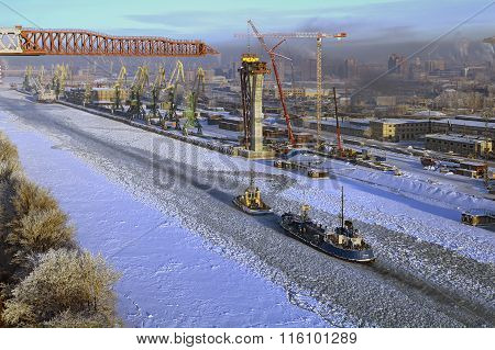 View Of Ice-covered Sea Canal Cargo Port And Small Vessels.