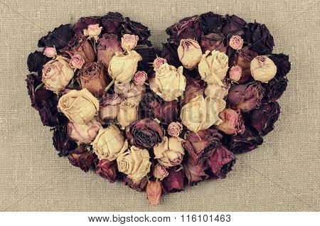 Heart Shape From Dry Roses On Linen Canvas Background