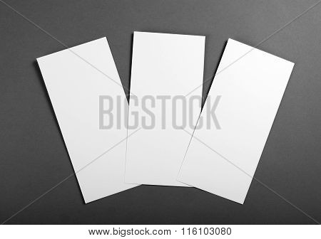 Blank flyer poster over grey background to replace your design.