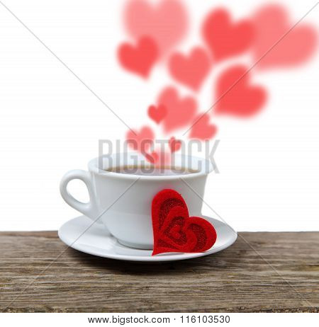 Cup Of Coffee And Heart On A Wooden Table