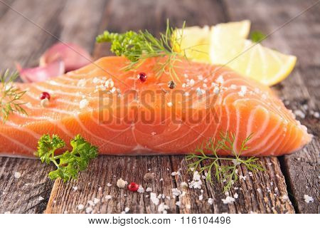raw salmon fish on wood