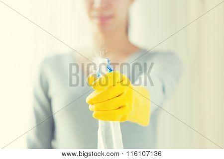 close up of happy woman with cleanser spraying