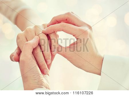 close up of lesbian couple hands with wedding ring