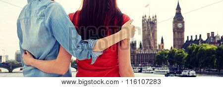 close up of happy lesbian couple over big ben