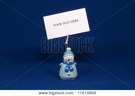 Showman with blank card isolated on blue