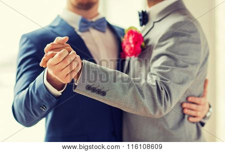 close up of happy male gay couple dancing