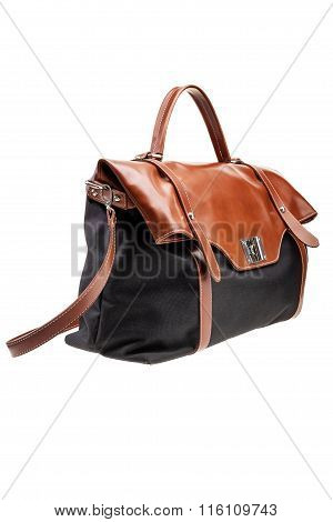 Black and brown womens bag isolated on white background.