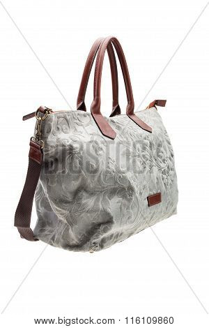 Grey patterned womens bag isolated on white background.