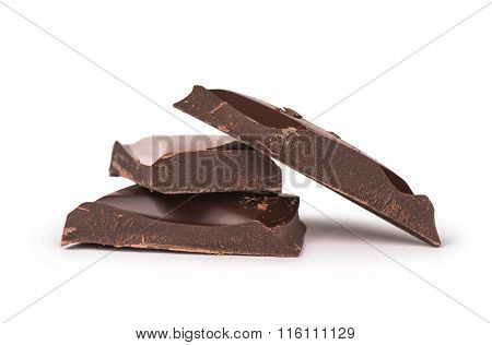 Pile Of Dark Chocolate Pieces Isolated On White Background