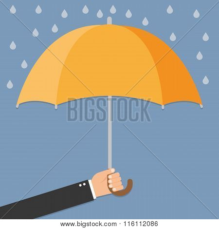 Hand Of Man Holding An Umbrella