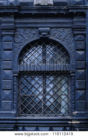 Black Window With A Stone Stucco, Plaster Patterned
