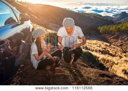 Couple having picnic near the car