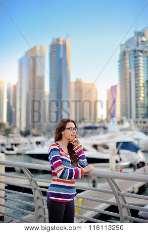 Brunette With Glasses On The Background Of Skyscrapers