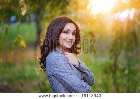 Beautiful Smiling Woman Walking In The Park