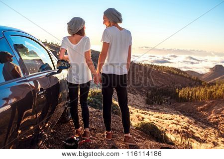 Couple standing together near the car