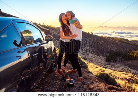 Couple having fun on the roadside