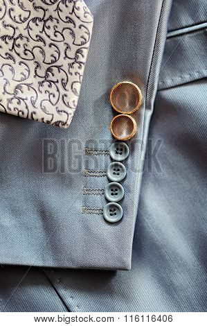 Wedding Rings On The Sleeve Of His Jacket The Groom