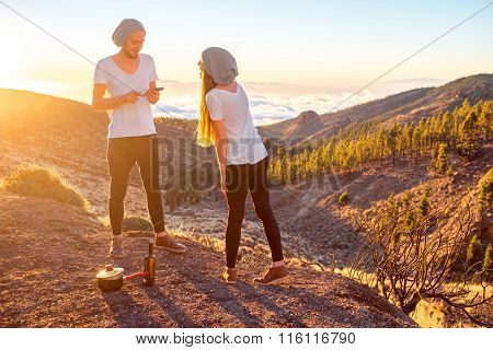 Couple talking on the beautiful landscape background