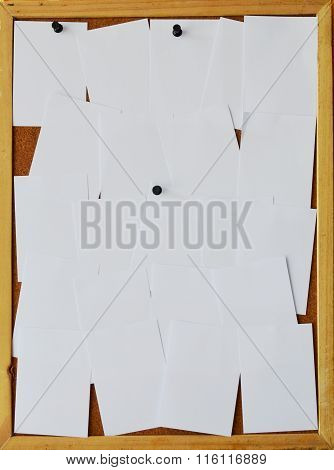 white paper stick on wooden notice board