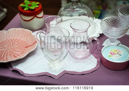 Glass And Porcelain Tableware Is On The Table