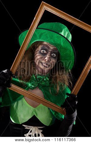 Madly Leprechaun Behind A Wooden Frame, Black Background