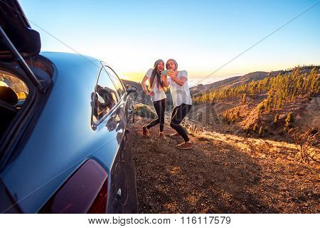 Couple having fun near the car