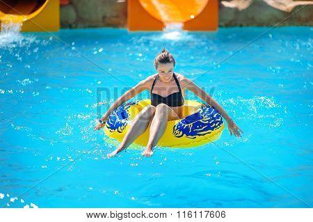 Beautiful Girl Riding A Water Slide