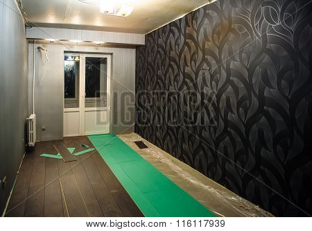 Renovated Apartment. The Process Of Laying Laminate