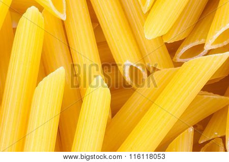Penne italian pasta as background