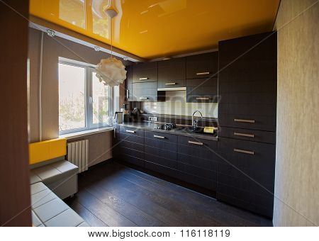 beautiful designer kitchen in brown and yellow colors stock photo