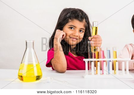 4 year old indian girl doing science experiment, science Education. asian kid and science experiment