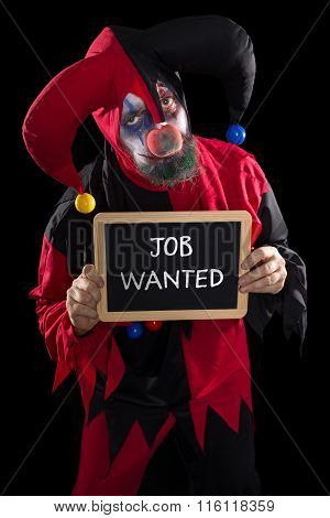 Sadly Clown Holding A Slate With Text Job Wanted, Concept Unemployed And Job Market