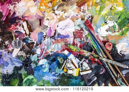 The Palette Of Artist For Mixing Paints And A Brush With A Knife