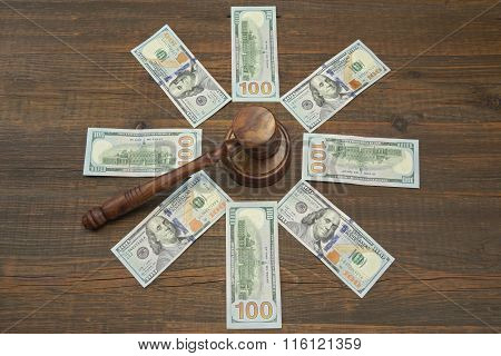 Judges Or Auctioneers Gavel And Dollar Cash On Wood Background
