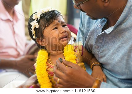 Baby girl prepared for the karnvedh events. Traditional Indian Hindus ear piercing ceremony. India special rituals.