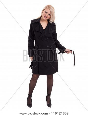 Full-length portrait of sexy young blonde woman in black clothes