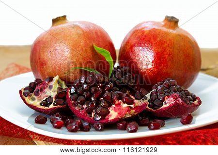 Juicy pomegranates on wood.