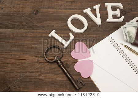 Wedding Concept. Hearts, Pen, Paper, Key, Money On Wood Background