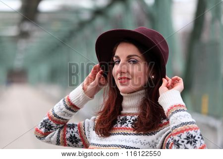 Smiling beautiful girl with a hat