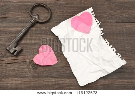Unrequited Love Concept. Vintage Key, Two Crumpled Heart, Blank Page