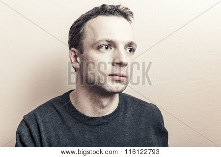 Young Serious Caucasian Man Stylized Studio Portrait