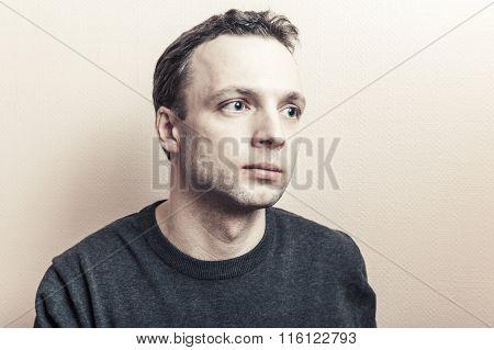 Young Serious Caucasian Man Stylized Studio Portrait