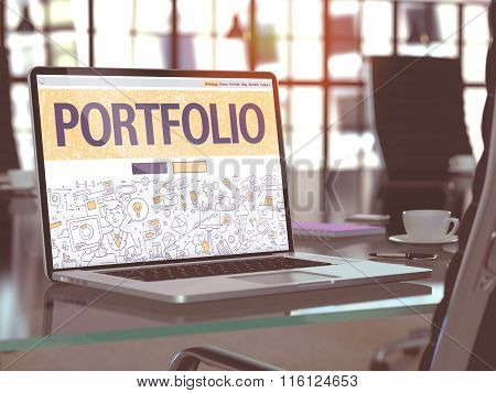 Portfolio on Laptop in Modern Workplace Background.