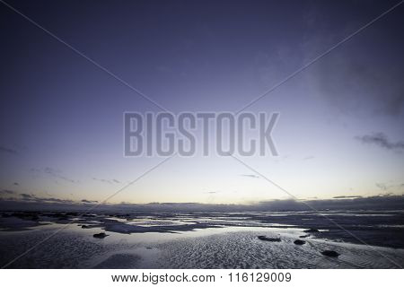 snowfield and water scenery of early spring on big lake