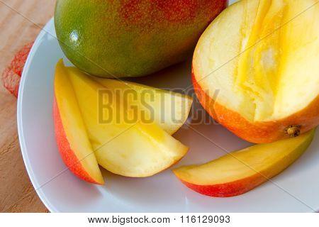 Mango fruit on wooden background.