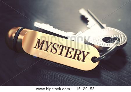 Keys with Word Mystery on Golden Label.