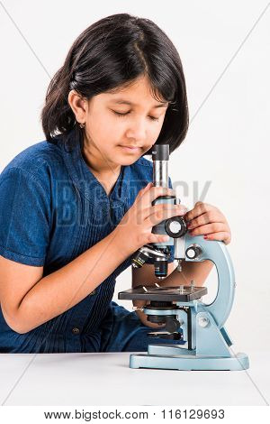 curious indian girl with microscope, asian girl with microscope, Cute little girl holding microscope
