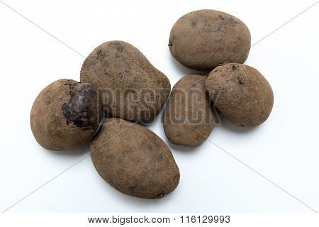 Potatoes On White Background Concept