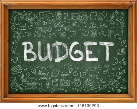 Hand Drawn Budget on Green Chalkboard.